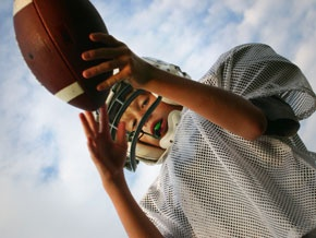 boy holds football