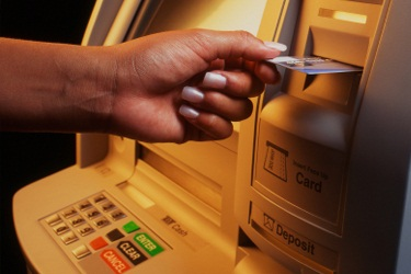 ATM (placing card in machine)